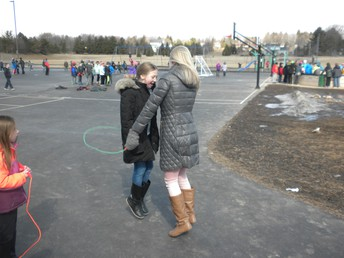 Even Ms. S gets into the jumping spirit with a 2nd grade friend.