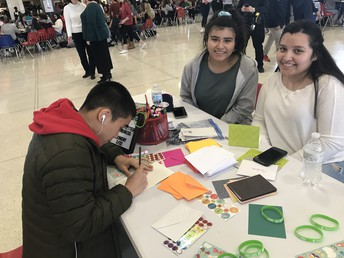 GHS Students sign kindness cards in the student center as part of their 'Say Something' Week of awareness