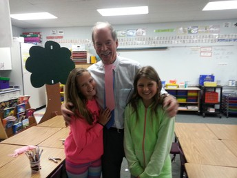 Grandpa was awarded a pink tie by these girls 4 yrs ago, and now they graduate next week.