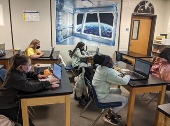 DMS students taking their jobshadow interest survey to determine their interests.