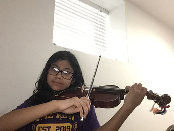 4th Grade violinist demonstrating her excellent technique!