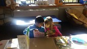 Ellana and Sahaj partner read in Ms. Sauerland's reading workshop.