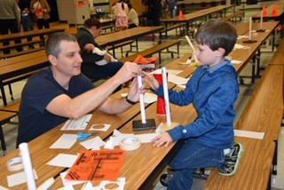 Families Learning to Build Rockets at STEAM Night