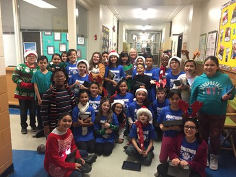 Mrs. Farley & the Panther Performers caroling through the halls of Pershing!