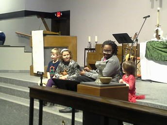 First-year UNT student Joshua Norman leads a Children's Sermon.