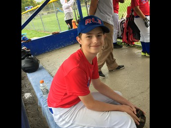 Justin enjoys some baseball