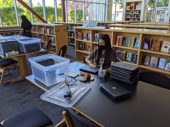 Students pitch in to prep technology