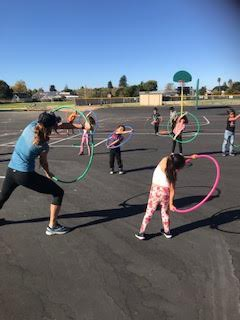 First Graders During a P.E. Lesson
