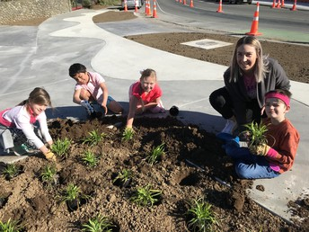Helping plant the front of the school