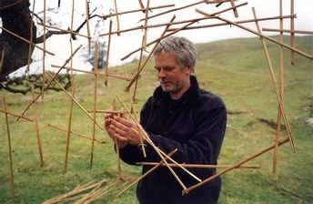 Andy Goldsworthy sculpting with sticks.