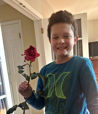 Brady D. leaving a rose for a neighbor!