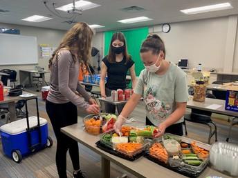 students prepare snacks