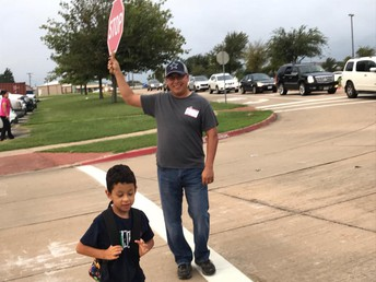 Even helping at the cross walk!
