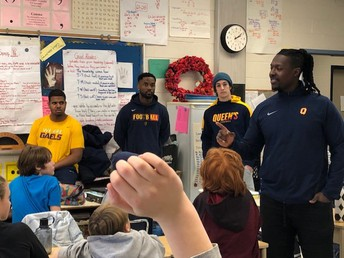 Queen's Football Players visit with inspiring messages and positive role-modelling