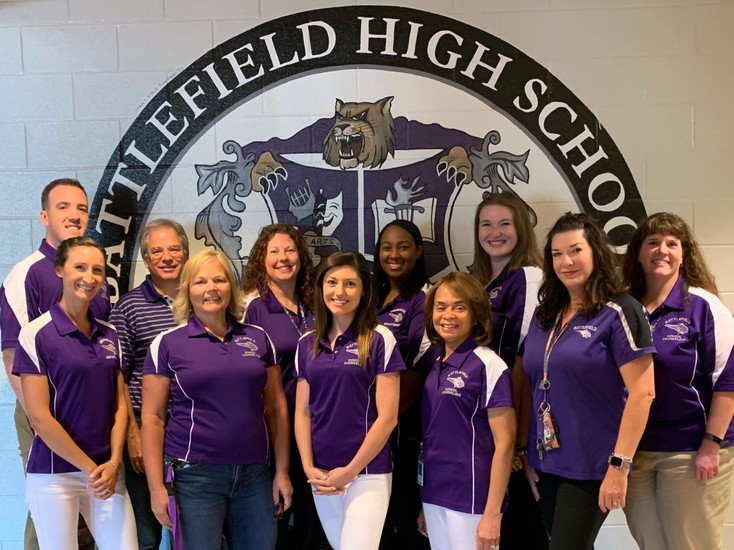 Battlefield High School Counselors: Back Row (left to right) Mr. Brier, Mr. Sisson, Ms. McGann, Ms. Epps, Ms. Lark, Ms. Byrne (Director). Front Row (left to right) Ms. Bridges, Ms. Swift, Ms. Bopp, Ms. Smith, Ms. Nguyen