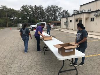 Parent volunteers working Filipino plate sale