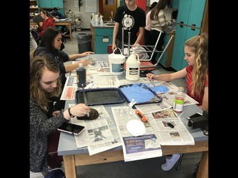 Students working on surreal mask assignment