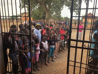 People of Makuleke Village line up to receive donated shoes from the communities of Wamogo and GEMS.