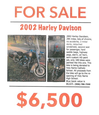This donated Harley Davison is for sale.