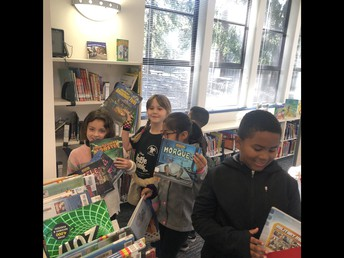 Students picking a book!