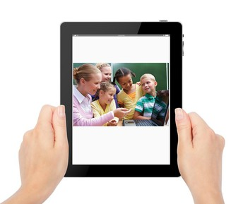 Person holding tablet with learning content