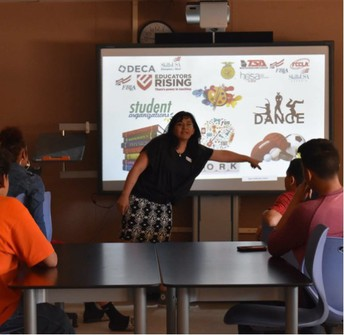 Dr. Trujillo leading a student workshop at Lynn Middle School in 2018