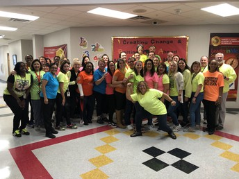 Staff at Samuel Gaines Academy of Emerging Technology Wearing Neon for Diversity Day