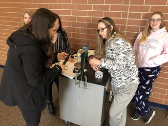 Students conduct experiments in physics
