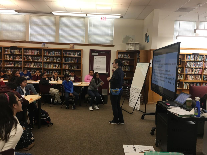 PE Teacher, Ms. Whittaker, leads 7th graders through TKF training.