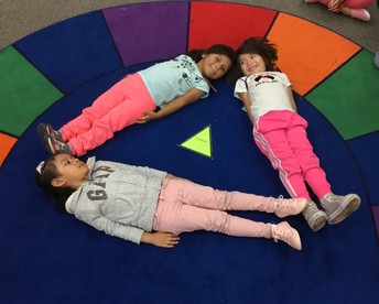 We can make a triangle with our bodies!