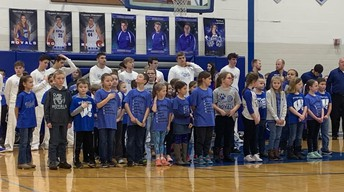 Second graders singing The National Anthem