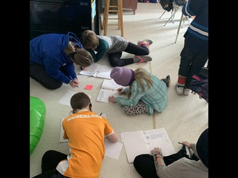Small group support - hard at work on our writing this week!
