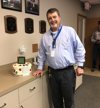 Wishing Gary Leimkuehler a happy retirement with cake and ice cream
