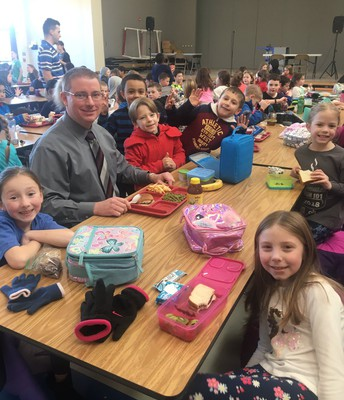 Chief Daniels from OJRSD Safety and Security enjoys a school lunch with second grade friends