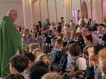 Fr Joe breaking open the Word of God