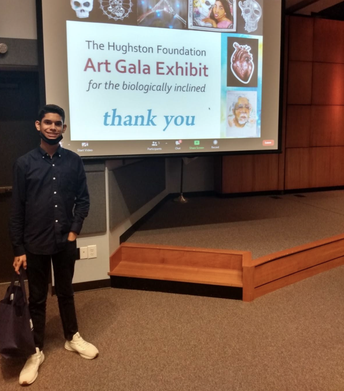 Graphic Design student, Samuel Jimenez, posing at The Hughston Foundation Art Gala Exhibit.