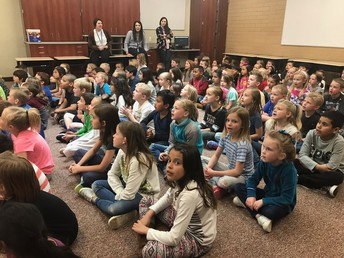 1st Grade Practicing for their Performance