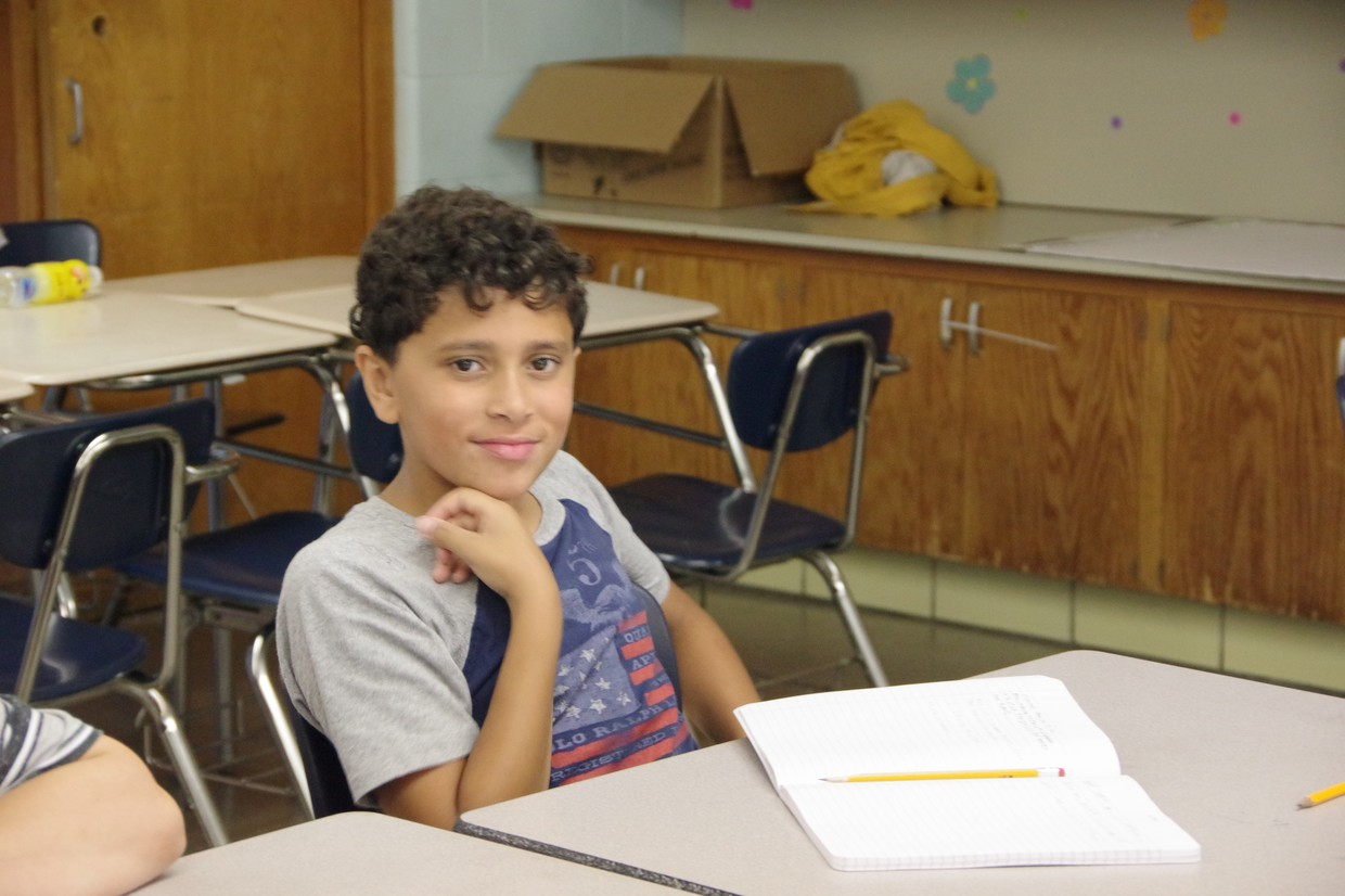 male student sitting at desk