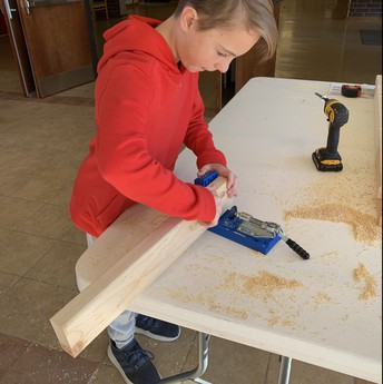 student working with wood