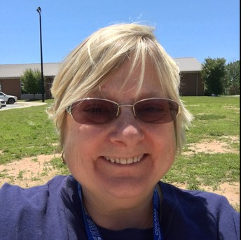 Mrs. Pirtle's smiling selfie outside