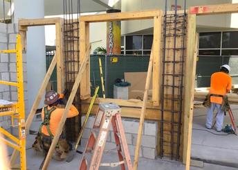 Contractors doing exterior work at a school