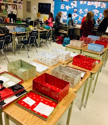 Ministry of Caring members meet after school to start packing shoeboxes