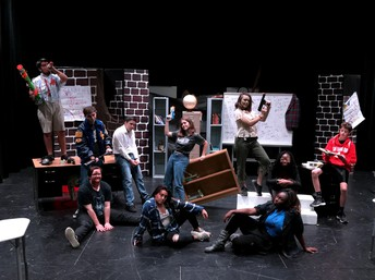 full cast poses on stage from the lunchtime production of 7 ways to survive the zombie apocalypse