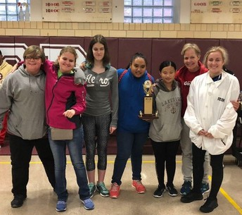 OSSB Girls Goalball team is pictured with their 3rd place trophy from Conference in Missouri.  Shown from left to right are Maggie, Autum, Emily, Lalita, Yaqi, Coach Picard and Sarah.