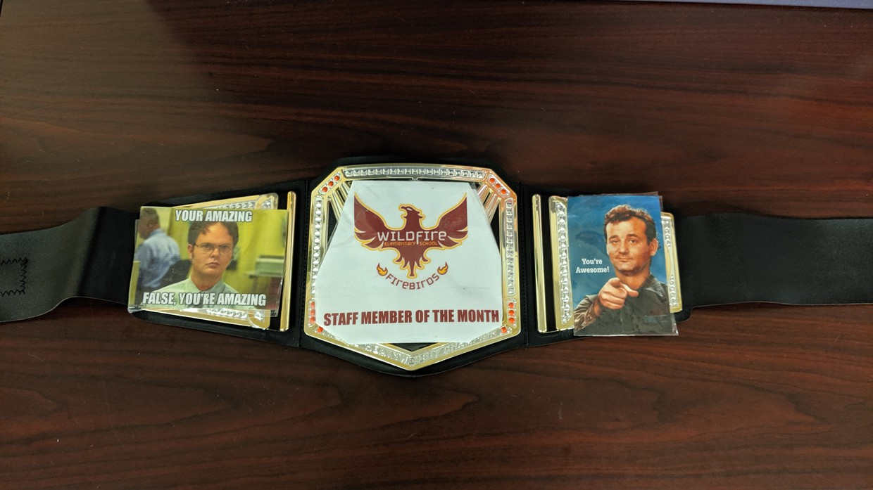 The staff member of the month championship belt