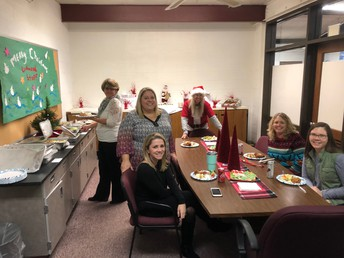 8TH GRADE TEACHERS ENJOYING THEIR HOLIDAY LUNCHEON