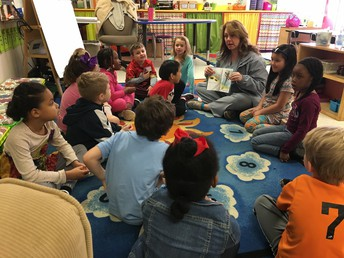 Mrs. Bates reading to students