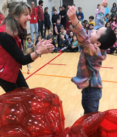 Mrs. Hutchins and Aidan celebrate his sweet victory win of the red giant balls!