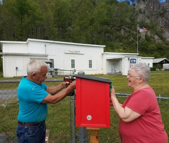 Picture of Dennis and Peggy Biller installing Free Little Library