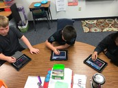 4th graders practicing their cursive spelling on their iPads.